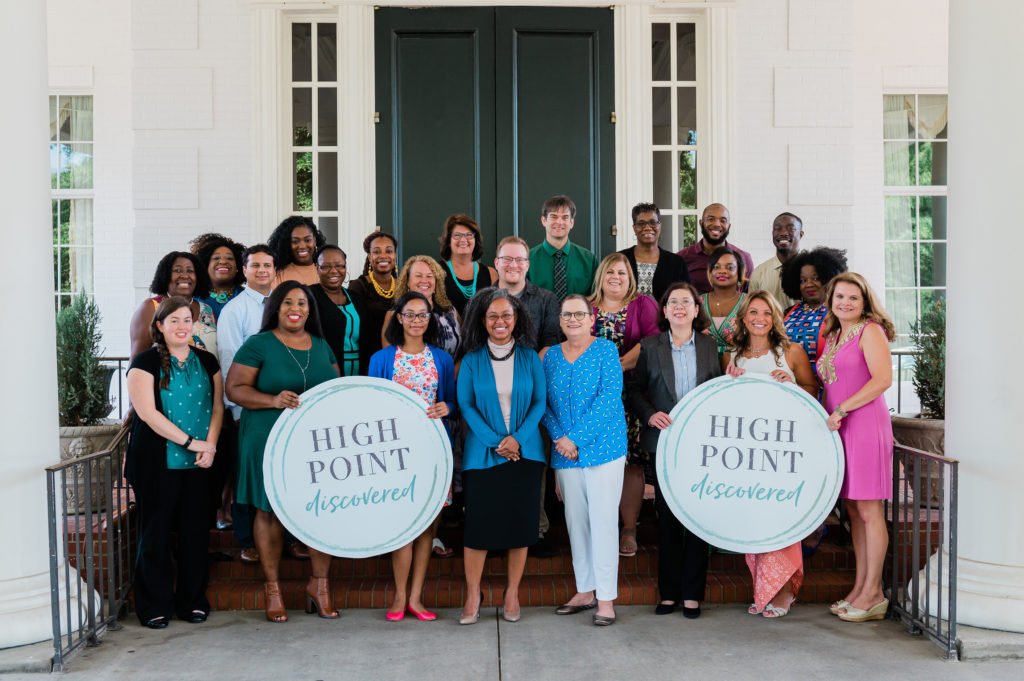A group of Extraordinary Educators in High Point stand on the front steps of the High Point Country Club.