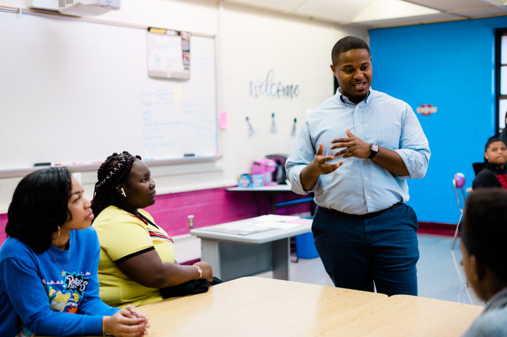 Cyril Jefferson speaks in a classroom as students watch.