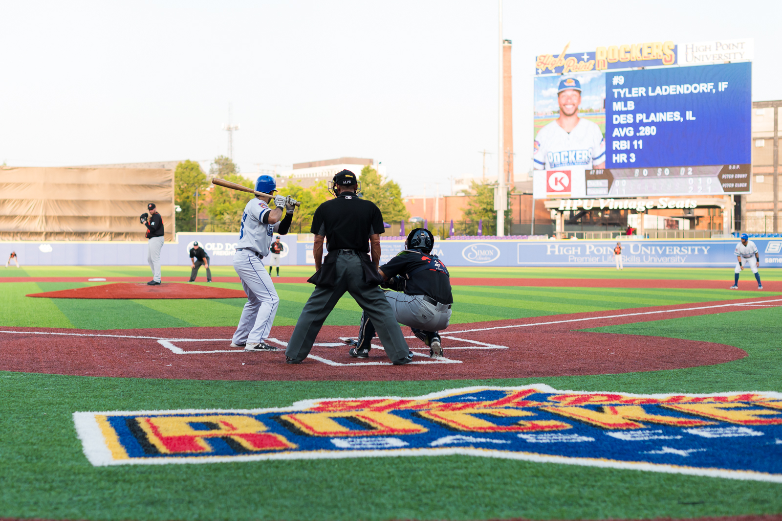 A picture of the High Point Rockers field with several players at home plate.