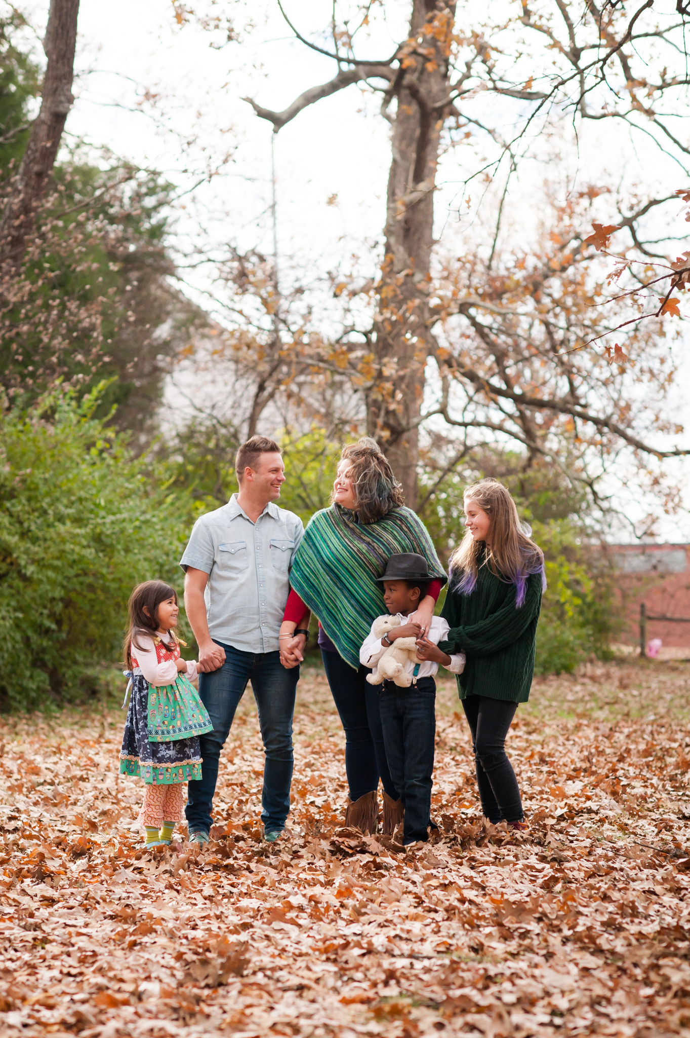 Shane Key and his wife and kids stand in fall leaves.