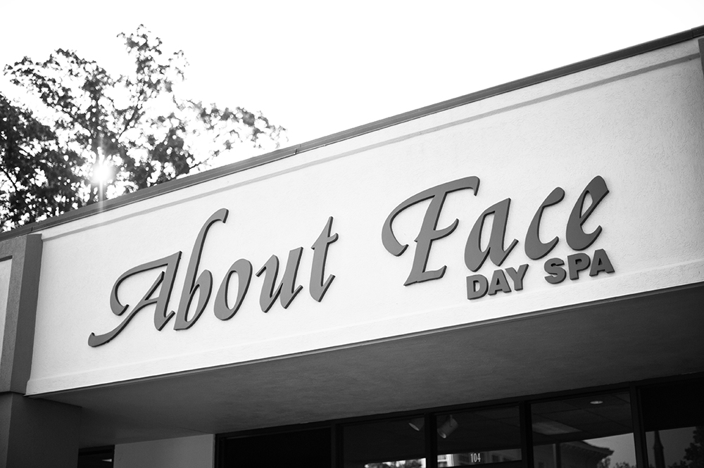 "The sign from ""About Face"" day spa."