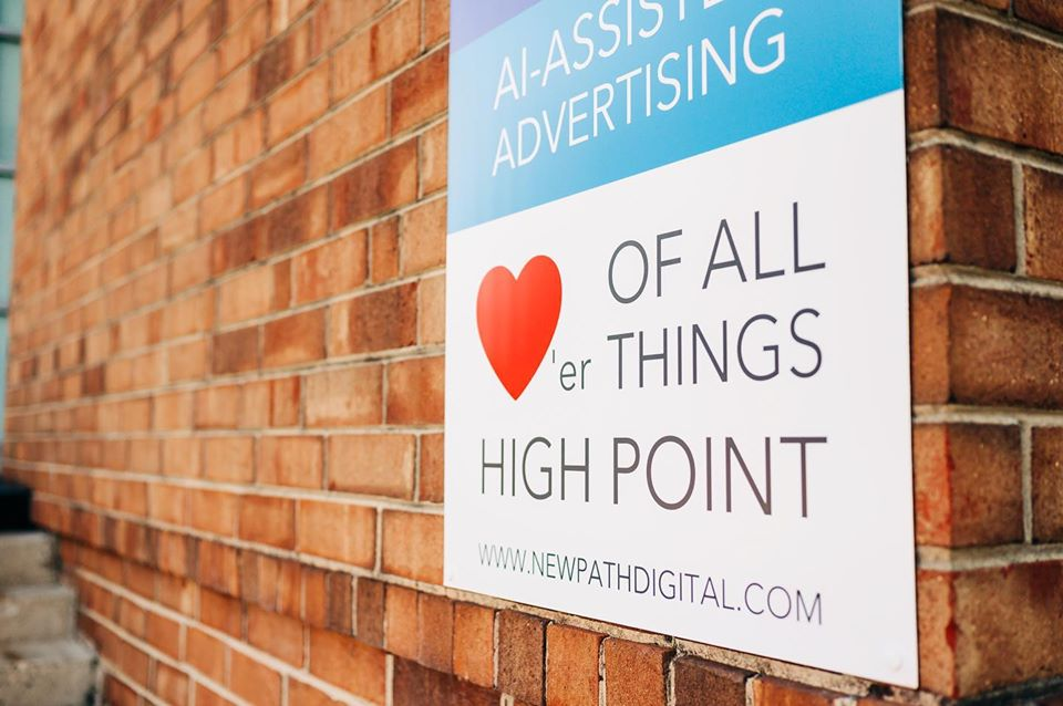 """A New Path Digital sign that says """"Lovers of all Things High Point."""""""