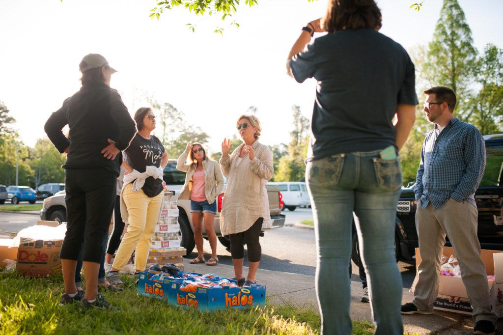 Lisa Hawley speaks to a group of volunteers at Feeding Lisa's Kids.
