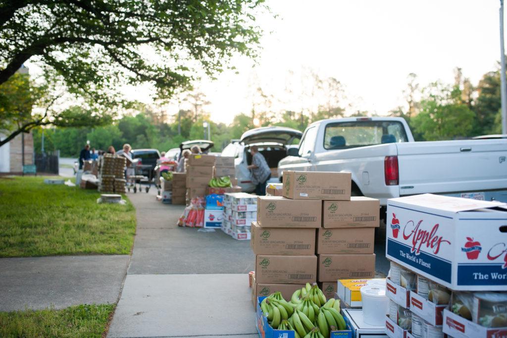 Crates of food line the sidewalk at the Feeding Lisa's Kids food distribution.