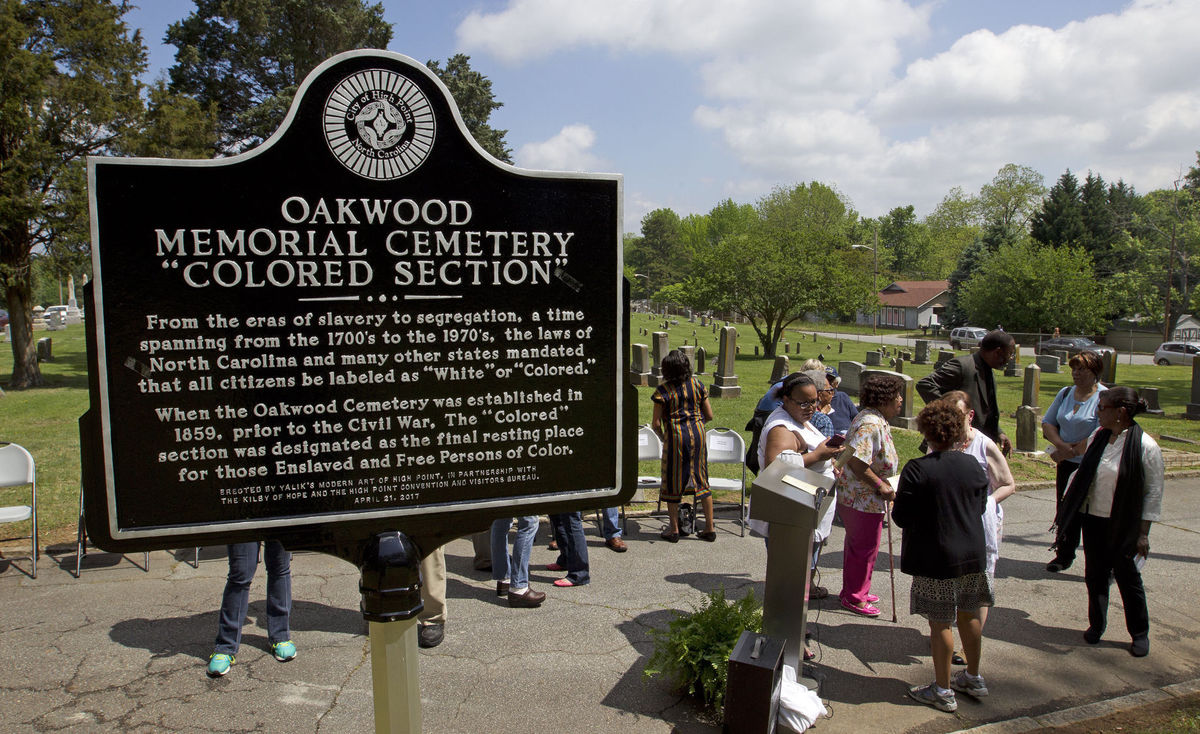 "Group gathers at a historic marker in High Point for ""Oakwood Memorial Cemetery 'Colored Section.'"""