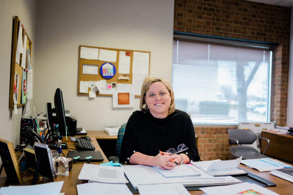 Molly Jordan, Executive Director at CCHP sits at her desk in the Community Clinic of High Point.