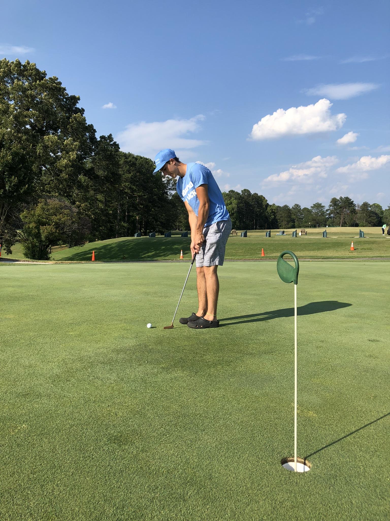 Golfer puts a golf ball on the Oak Hollow Golf Course.