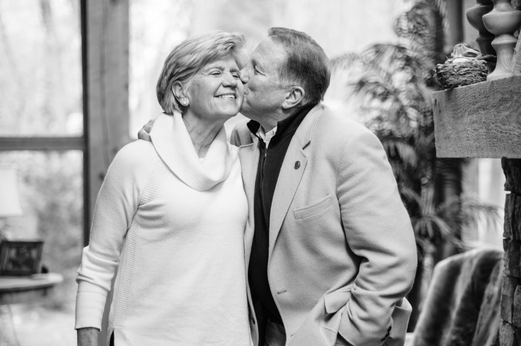 Paul Lessard kisses his wife, Jayne Lessard on the cheek.