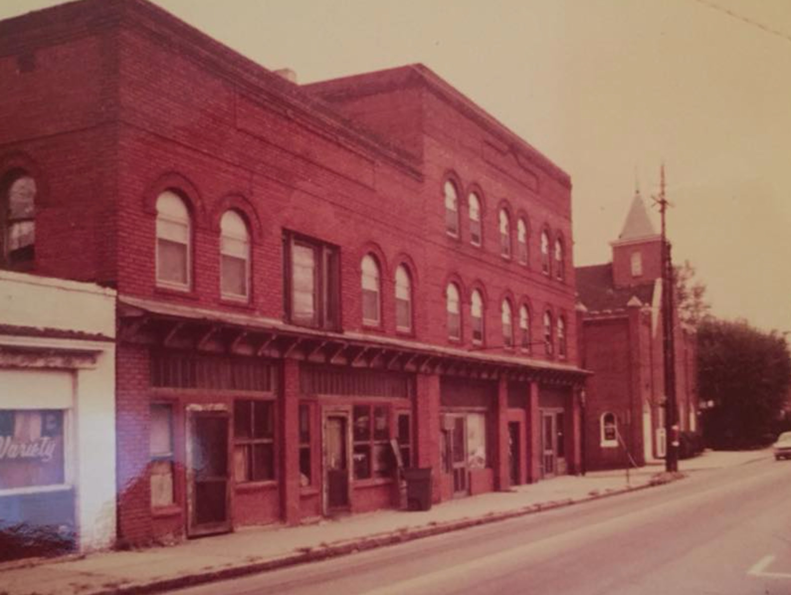 A historic image of the Kilby Hotel and arcade building in High Point, NC.