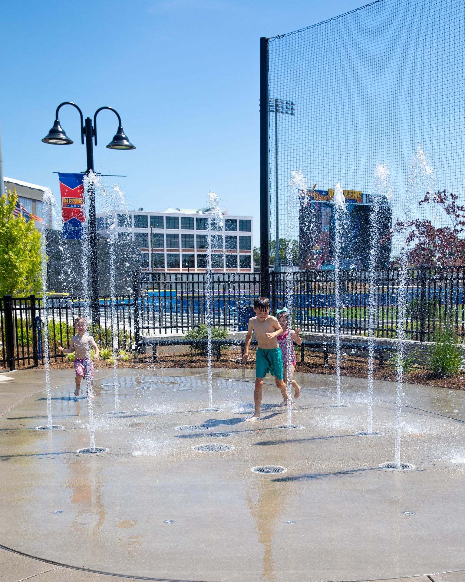 At Blessing Park in High Point, NC, kids play in the splash pad at the High Point Rockers stadium.