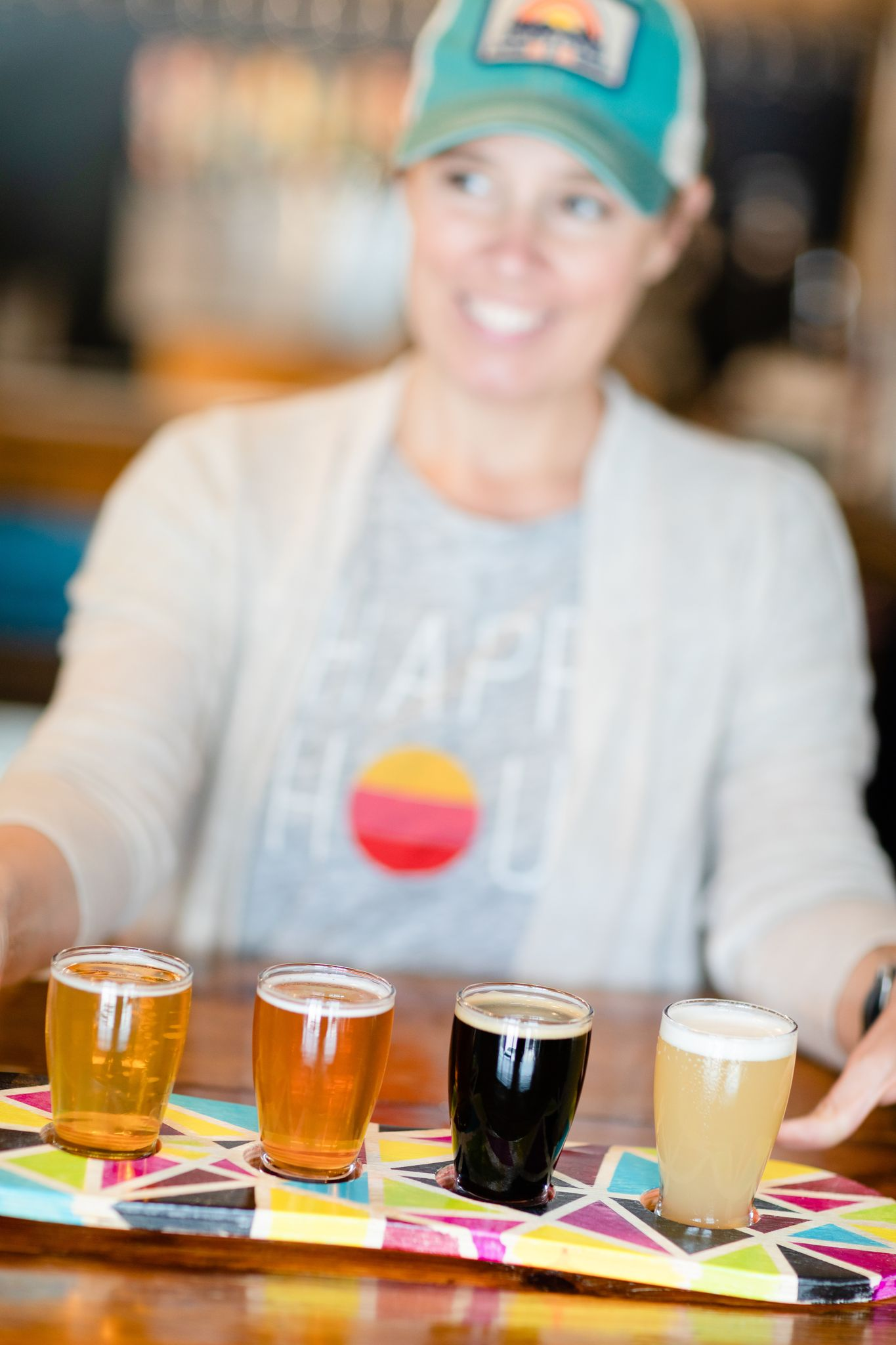 Tiffany Thompson holds out a flight of beers from Goofy Foot Taproom in High Point, NC.