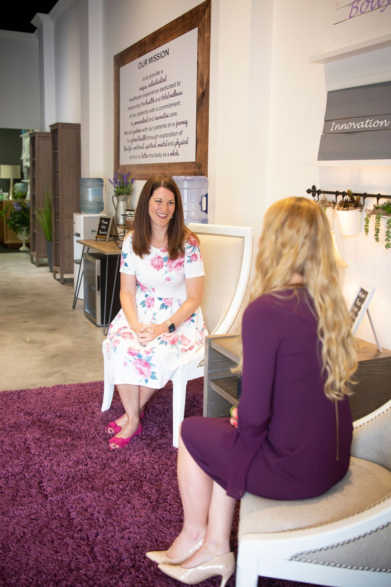 Tiffany Allen, nurse practitioner at Triad Lifestyle Medicine speaks with her associate in the lobby.