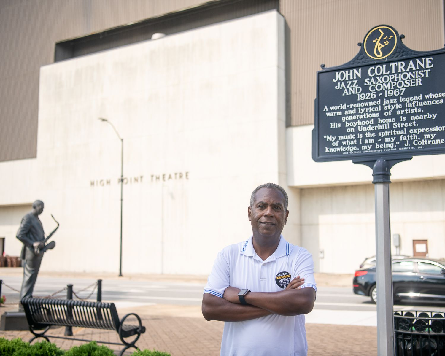 Joe Williams stands in front of John Coltrane's statue in High Point, NC.